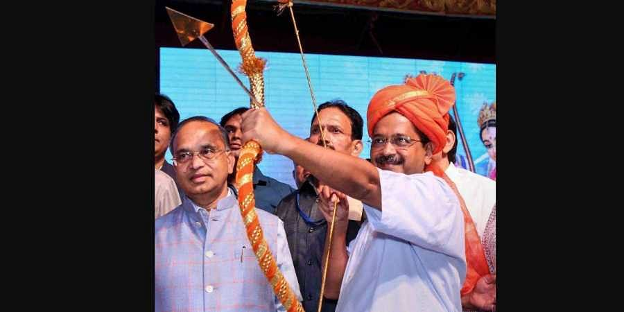 Delhi Chief Minister Arvind Kejriwal holds a bow and arrow at Luv Kush Ramleela on the occasion of Dussehra in New Delhi.
