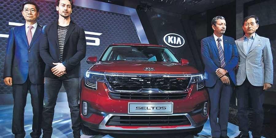 Kia MD & CEO Kookhyun Shim and Bollywood actor Tiger Shroff at the launch of Kia Seltos in New Delhi.