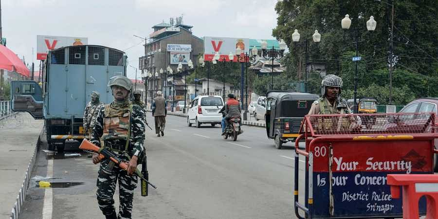 Security personnel stand guard on the 64th day of strike after the abrogration of Article 370A and bifurcation of State in Srinagar Monday Oct. 7 2019.   (Photo   PTI)