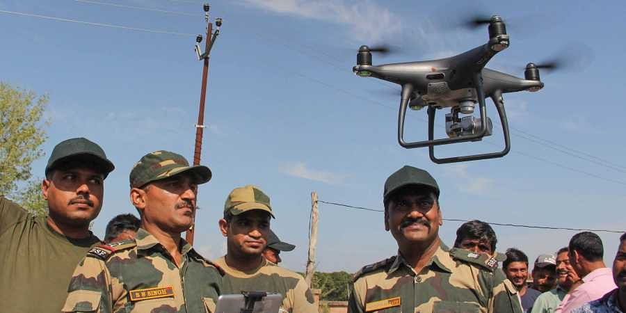 BSF officials explain the working of drone to the border area villagers at Gole Pattan village in Kanachak sector of Indo-Pak border about 25 kms from Jammu Saturday Oct. 5 2019. | (Photo | PTI)