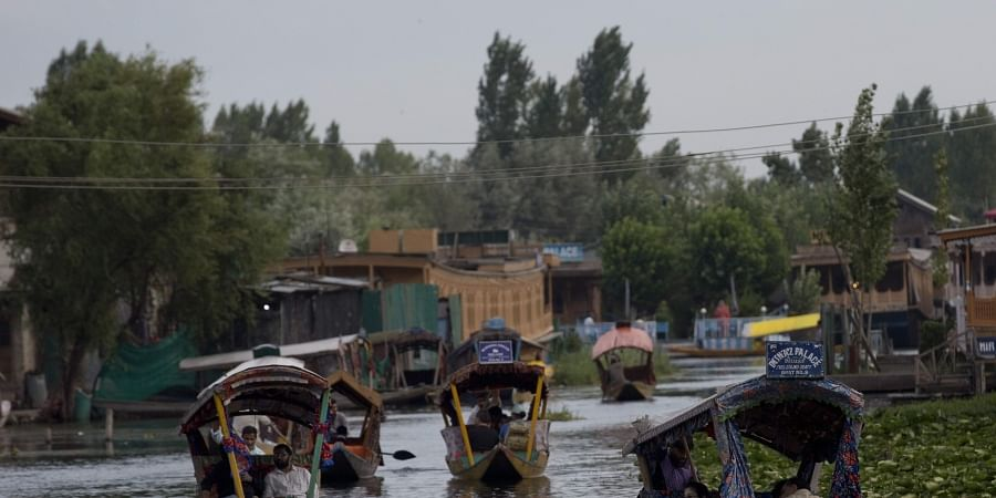 In this Saturday, Aug. 3, 2019, file photo, Tourists in Shikaras, a traditional gondola, cross the Dal Lake as they prepare to leave Srinagar. | (File | AP)