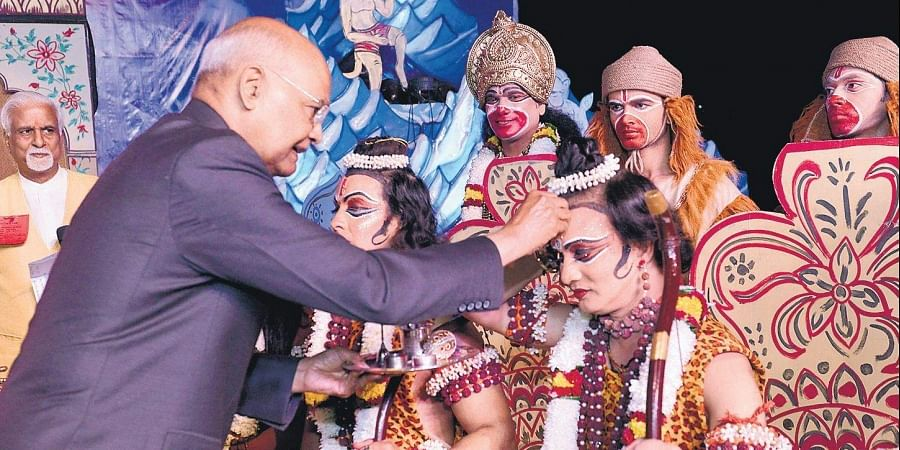 President Ram Nath Kovind applies tilak on the forehead of artists depicting Ram and Laxman during the Dussehra celebrations of Shree Ramlila  Committee at Indraprastha, in New Delhi, on Tuesday.