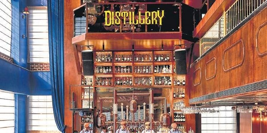 (Top) Interiors of Distillery; (left) one of the bar's highlights, Beverly Hills.