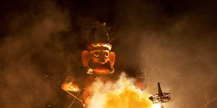 An effigy of demon king Ravana's brother burns during Dussehra