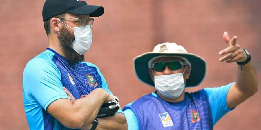 Bangladesh cricket team head coach Russell Domingo (R) and bowling coach Daniel Vettori wearing face masks watch the team during a practice session at Arun Jaitley Cricket Stadium in New Delhi. (Photo | AFP)