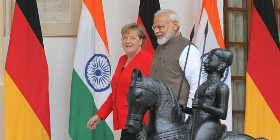 German Chancellor Angela Merkel was welcomed by PM Narendra Modi at the forecourt of the President House.