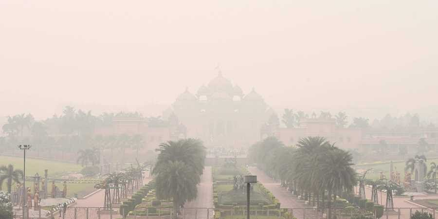 A view of Akshardham temple shrouded in heavy smog post-Diwali celebrations, in New Delhi