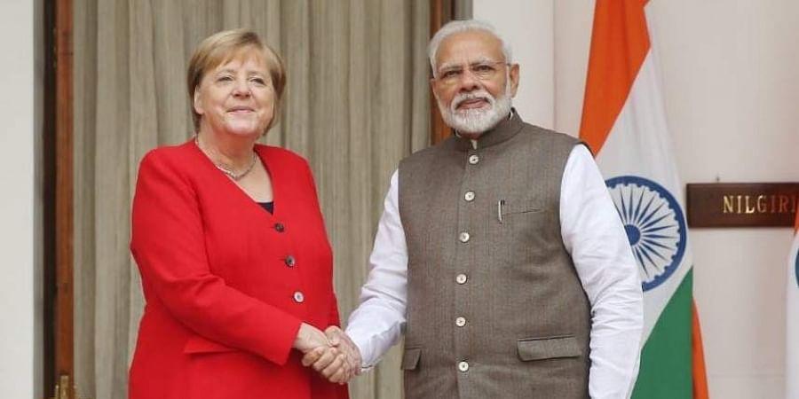 German Chancellor Angela Merkel (L) with PM Narendra Modi