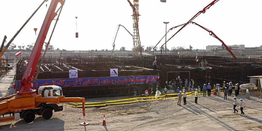 In this photo by the Atomic Energy Organization of Iran, concrete is poured for the base of the second nuclear power reactor at Bushehr plant, some 440 miles (700 kilometers) south of the capital Tehran, Iran, Sunday, Nov. 10, 2019.