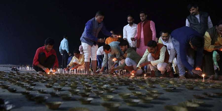 People offering puja at Saryuriver at Ayodhya on the Day of Ayodhya land dispute judgement. | (Photo | Shekhar Yadav/EPS)