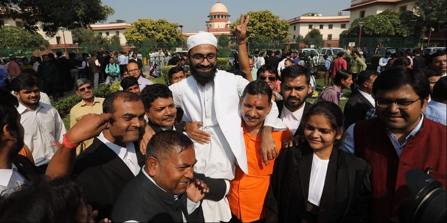 People celebrates after the verdict of Ayodhya Babri Masjid Land case at the lawn of the Supreme Court of India in New Delhi on Saturday. | (Photo | Arun Kumar | EPS)