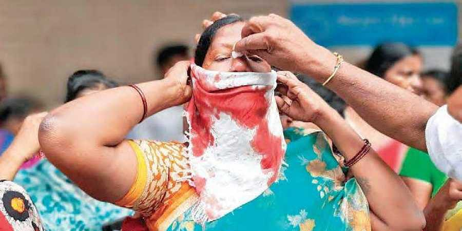 A woman protester bleeding profusely after being injured during the police lathi charge