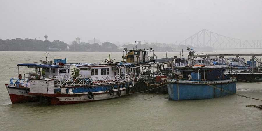 Mechanized boats and ferries stand moored at an empty jetty as ferry services were suspended due to cyclonic storm, on the Hooghly River in Kolkata, India, Saturday, Nov. 9, 2019. | (Photo | AP)