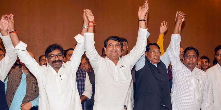 MM Supremo Hemant Soren (L), Congress leader RPN Singh (C), Congress Jharkhand President Rameshwar Oraon (2R) along with other RJD leaders address a joint press conference to declare seat sharing for the forthcoming Assembly election in Ranchi, Jharkhand Nov. 8 2019. | (Photo | PTI)
