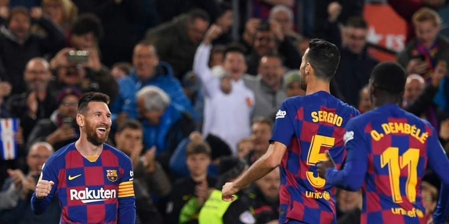 Barcelona's Argentine forward Lionel Messi (L) celebrates after scoring during the Spanish league football match between FC Barcelona and RC Celta de Vigo at the Camp Nou stadium in Barcelona. (Photo | AFP)