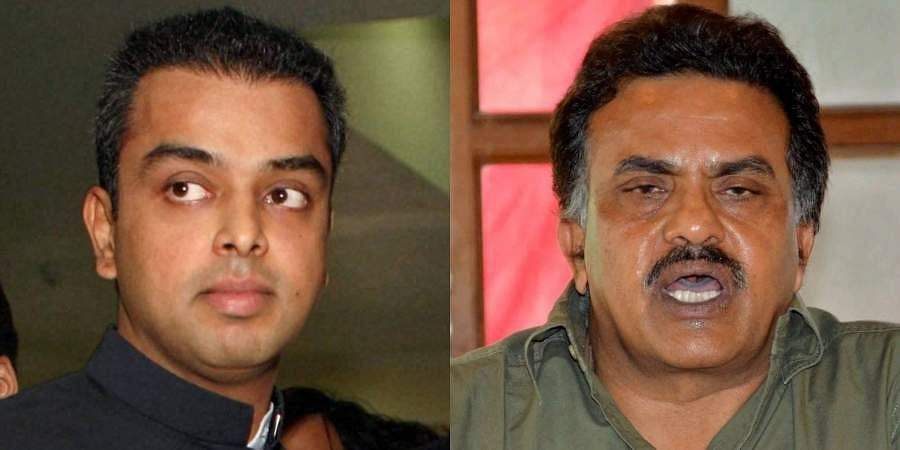 Senior Congress leaders Milind Deora (L) and Sanjay Nirupam