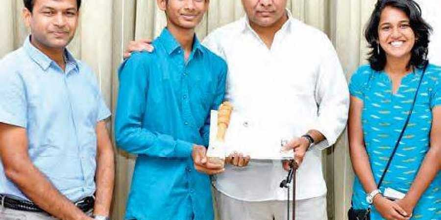 Ashok, a Class XII student who won first prize at India International Science Festival, with IT Minister KT Rama Rao at Pragathi Bhavan in Hyderabad.
