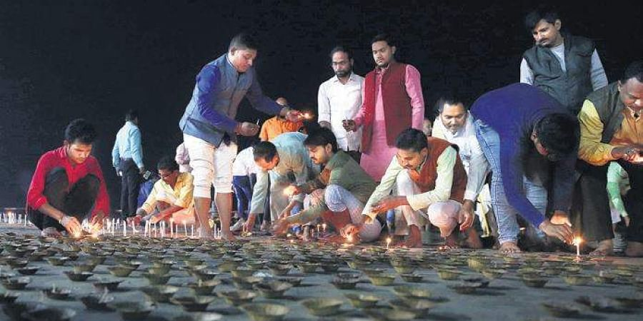 People offer puja at Saryu river in Ayodhya on the day of verdict.