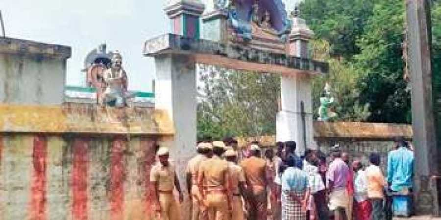 Police personnel at the temple in Chokkanathapuram village in Ariyalur district, where locals denied entry to Dalit couple to get married