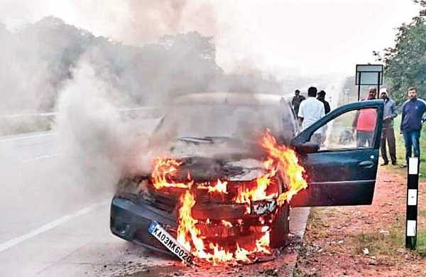 Moving car catches fire on Nice Road