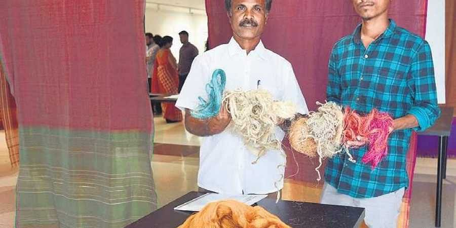 C Shekar and his son at a handloom expo at BIC