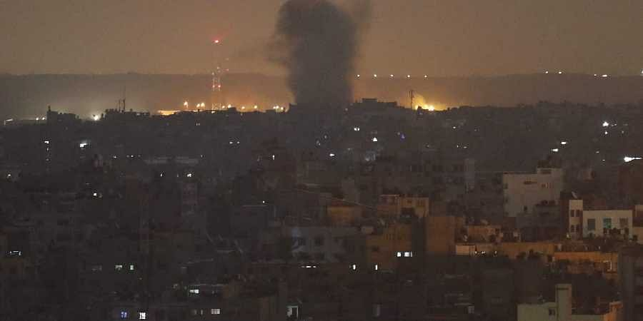 An explosion caused by Israeli airstrikes is seen in Gaza City, early Thursday, Nov. 14, 2019.