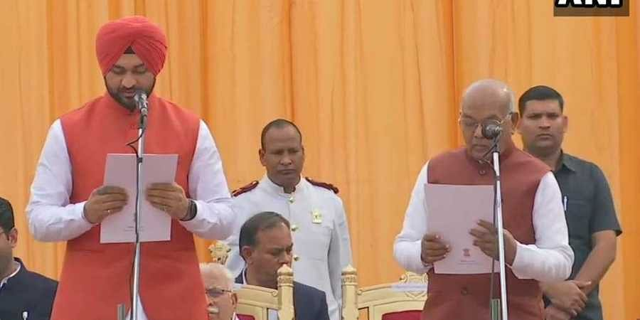 Haryana governor Satyadeo Narain Arya administered the oath to newly inducted ministers at a ceremony at the lawns of Raj Bhawan.