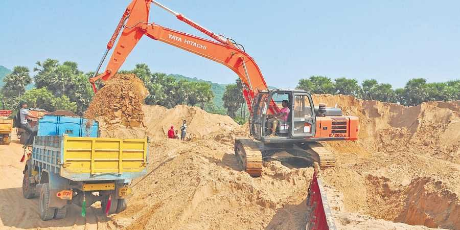 Sand being loaded into a truck at a stockpoint at Mudasarlova in Visakhapatnam on Wednesday