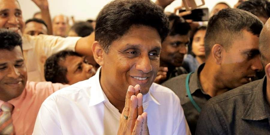 Presidential candidate representing Sri Lanka's governing party Sajith Premadasa greets the gathering as he leaves after a meeting with a group of civil society members in Colombo, Sri Lanka.