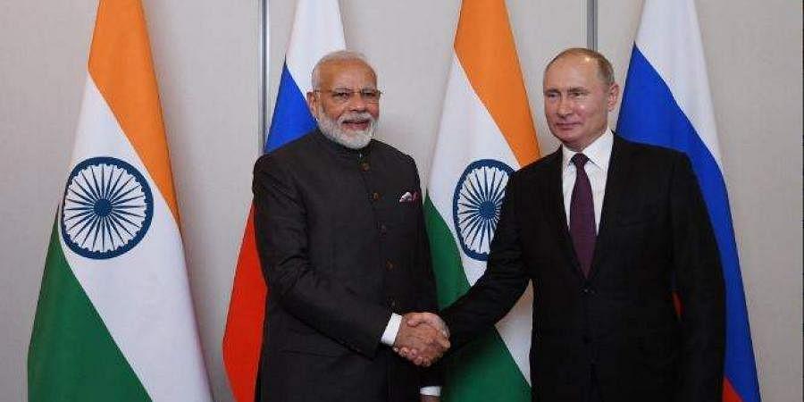 Russian President Vladimir Putin meets Indian Prime Minister Narendra Modi in Brazil.