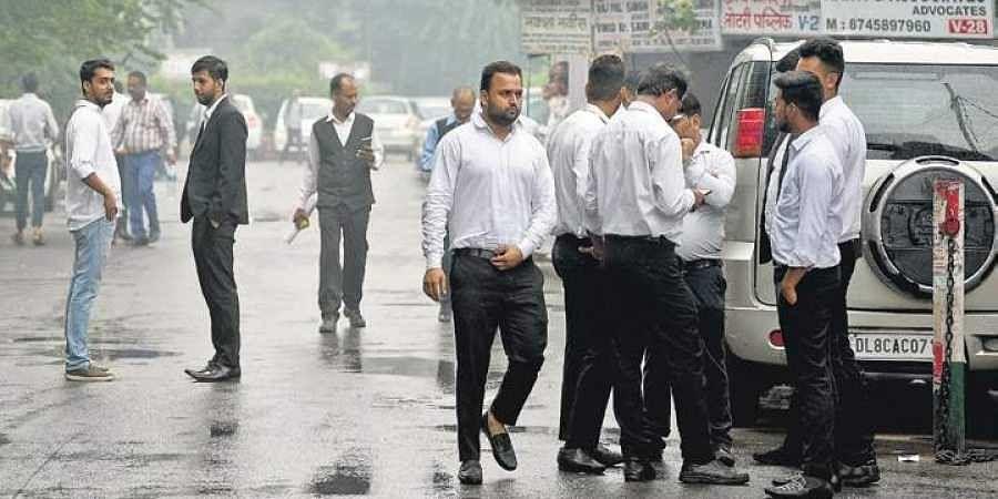 Protesting lawyers outside Tis Hazari Court in New Delhi. | (File | EPS)