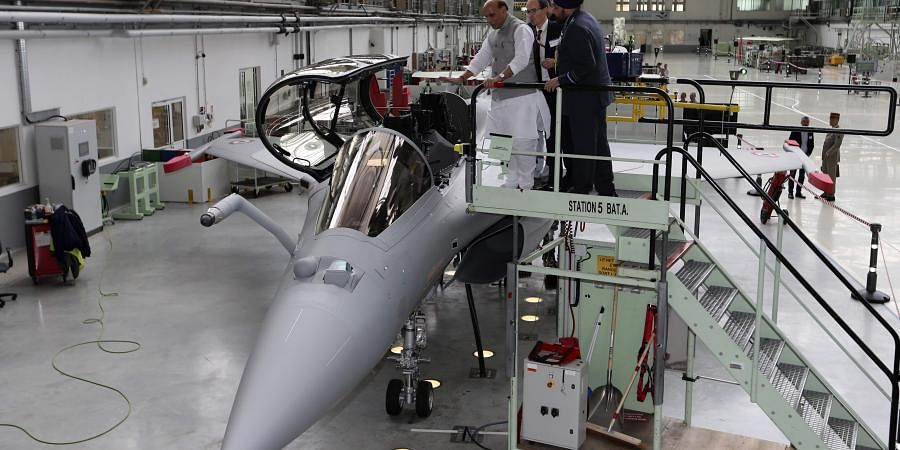 Union Defense Minister Rajnath Singh stands by a Rafale jet fighter in Merignac in southwestern France on Tuesday. Singh formally accepted the first Rafale fighter jet after India had signed a deal with the French government and Dassault Aviation in September 2016, to acquire 36 Rafale fighter jets. | (File | AP)