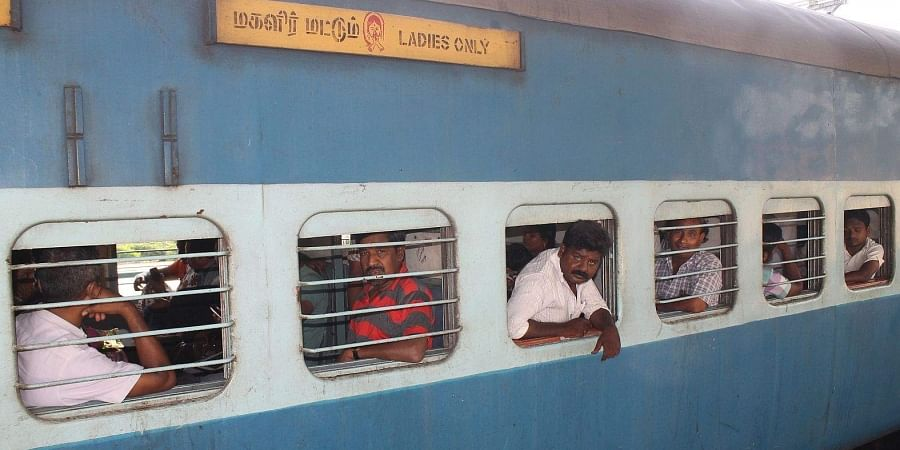 Males occupying a compartment meant for ladies in one of the trains at Villupuram Railway Station.