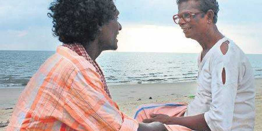 Mani sharing a light moment with Indrans in a scene from the film 'Udalaazham'