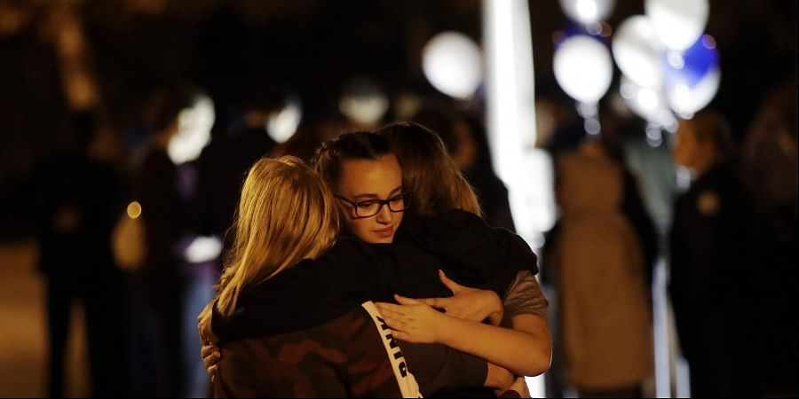 Students embrace during a vigil at Central Park in the aftermath of a shooting at Saugus High School Thursday, Nov. 14, 2019, in Santa Clarita, California.