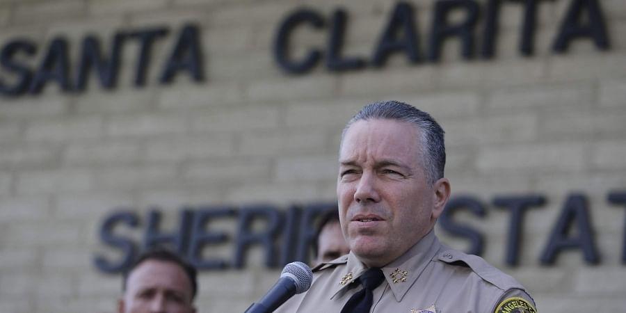Los Angeles Sheriff Sheriff Alex Villanueva expresses his condolences for the victims of the shooting at Saugus High School at a news conference at the station Santa Clarita, Calif., Friday, Nov. 15, 2019.