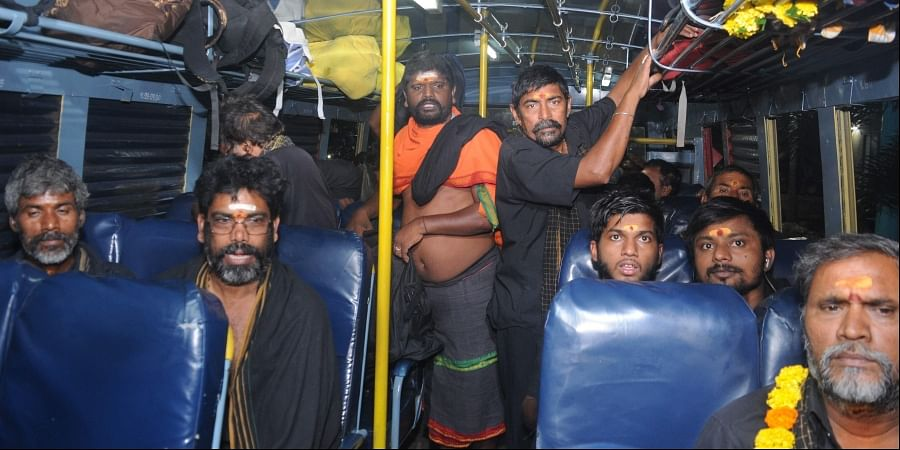 The first batch of Ayyappa devotees from Telangana who arrived in Kochi by train on Friday proceeding to Pamba by a KSRTC special service which commenced operation from Ernakulam KSRTC stand on Friday.   (Photo   A Sanesh/EPS)