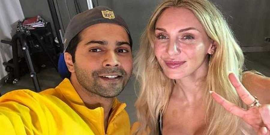Varun Dhawan with wrestler Charlotte Flair.