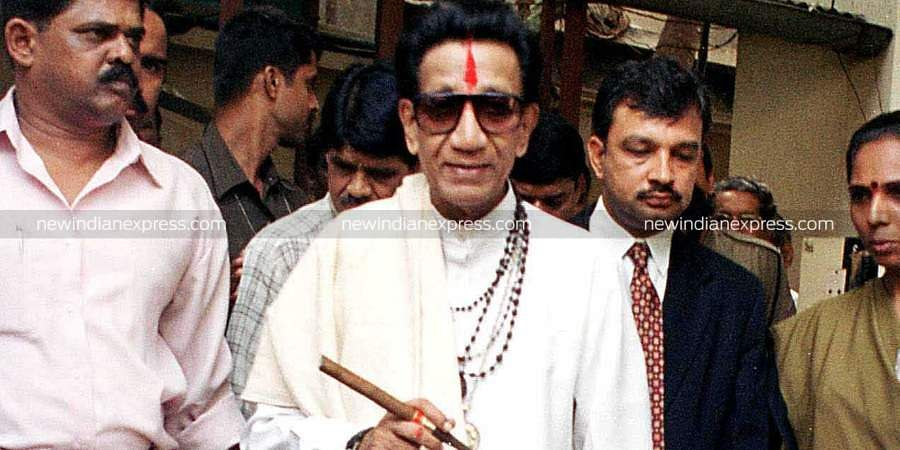 Then Shiv Sena chief Bal Thackeray surrounded by his supporters steps out of his suburban home in Mumbai.