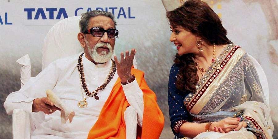 Then Shiv Sena chief Bal Thackeray sharing a word with Bollywood actress Madhuri Dixit during Deenanath Mangeshkar awards ceremony.