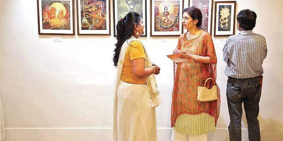 Art aficionados at the ongoing art exhibition featuring works of 15 artists