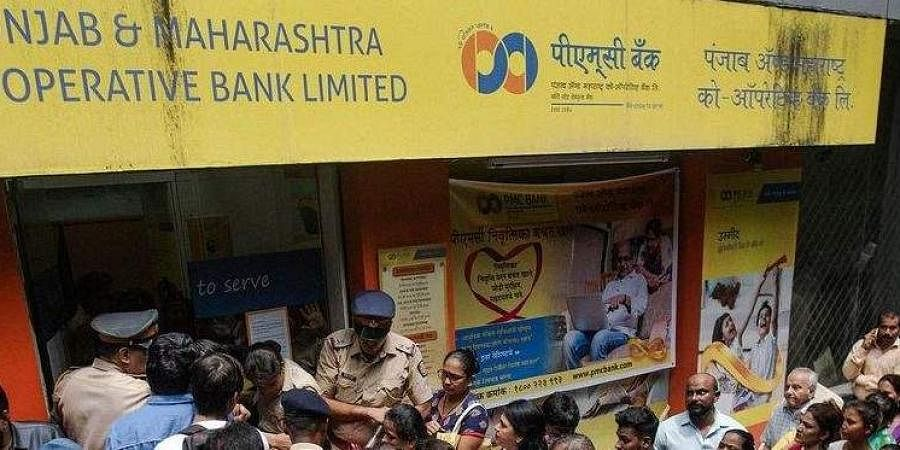 Account holders line up in front of a branch of PMC Bank (Photo| Bloomberg)