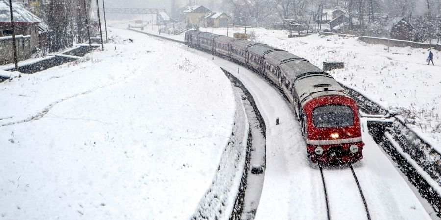 A train trails on a snow-covered Srinagar-Banihal railway track following fresh snowfall in Anantnag taken on 13/12/2018. (File Photo | PTI)