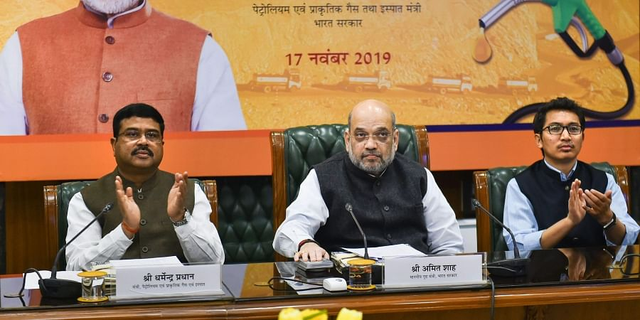 Home Minister Amit Shah with Petroleum Minister Dharmendra Pradhan and Ladakh MP Jamyang Tsering Namgyal during the launch of winter-grade diesel for Ladakh in New Delhi Sunday Nov. 17 2019.