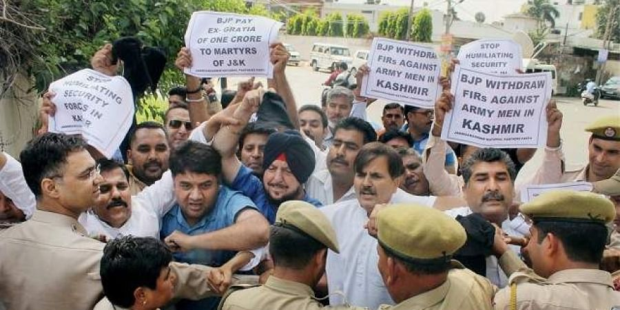 Jammu and Kashmir National Panthers Party (JKNPP) members scuffle with police during a protest.