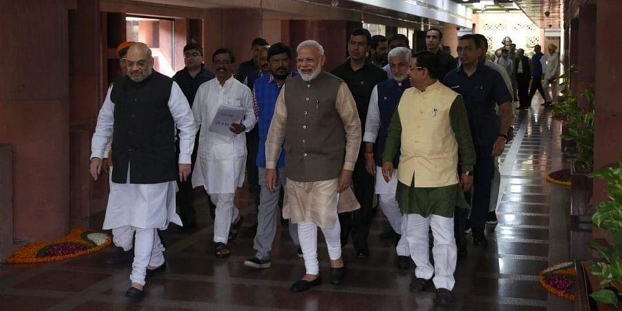 Prime Minister Narendra Modi, Home Minister Amit Shah and Parliamentary Affairs Minister Prahlad Joshi and others leave after attend an all party meeting ahead of the winter session of Parliament at Parliament Library Building in New Delhi on Sunday Novem