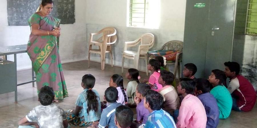 A Government School Teacher taking class for Tribal students in Erode. Image is used for representational purposes.