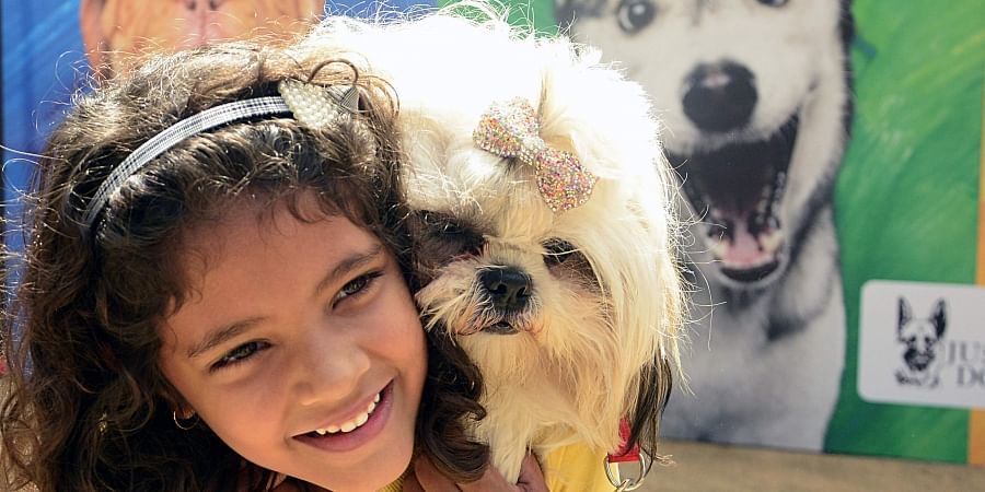 Pet Lovers with pets during 'Pet Festival' at Jayamahal Palace Ground in Bengaluru on Saturday