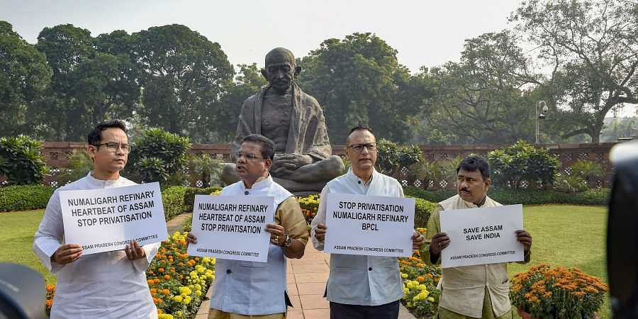 Congress MP Gaurav Gogoi and other MPs display placards to protest against proposed privatisation of Numaligarh Refinery during the Winter Session of Parliament in New Delhi Tuesday