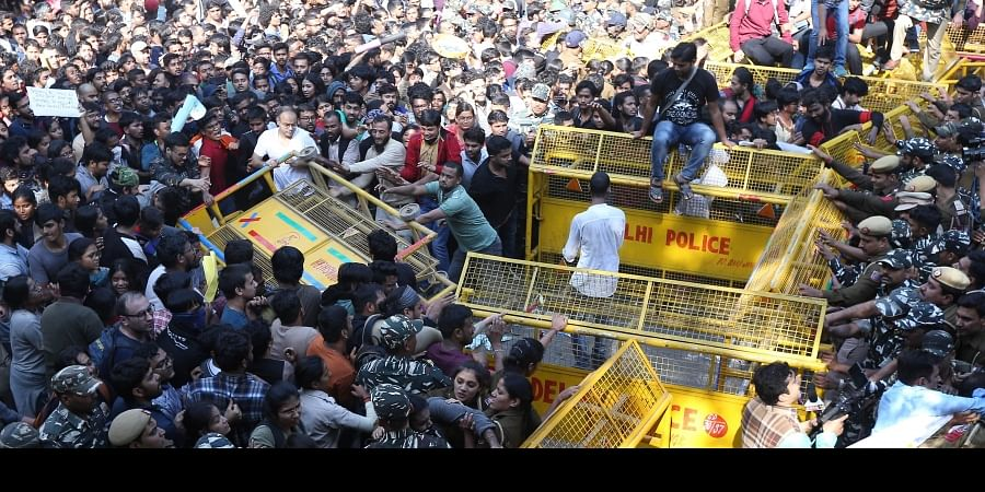 Jawaharlal Nehru University students try to get past police barricades during a protest march towards Parliament on the first day of the Winter Session demanding a total rollback of the hostel fee hike in New Delhi Monday Nov. 18 2019. | (Photo | Arun Kumar/EPS)